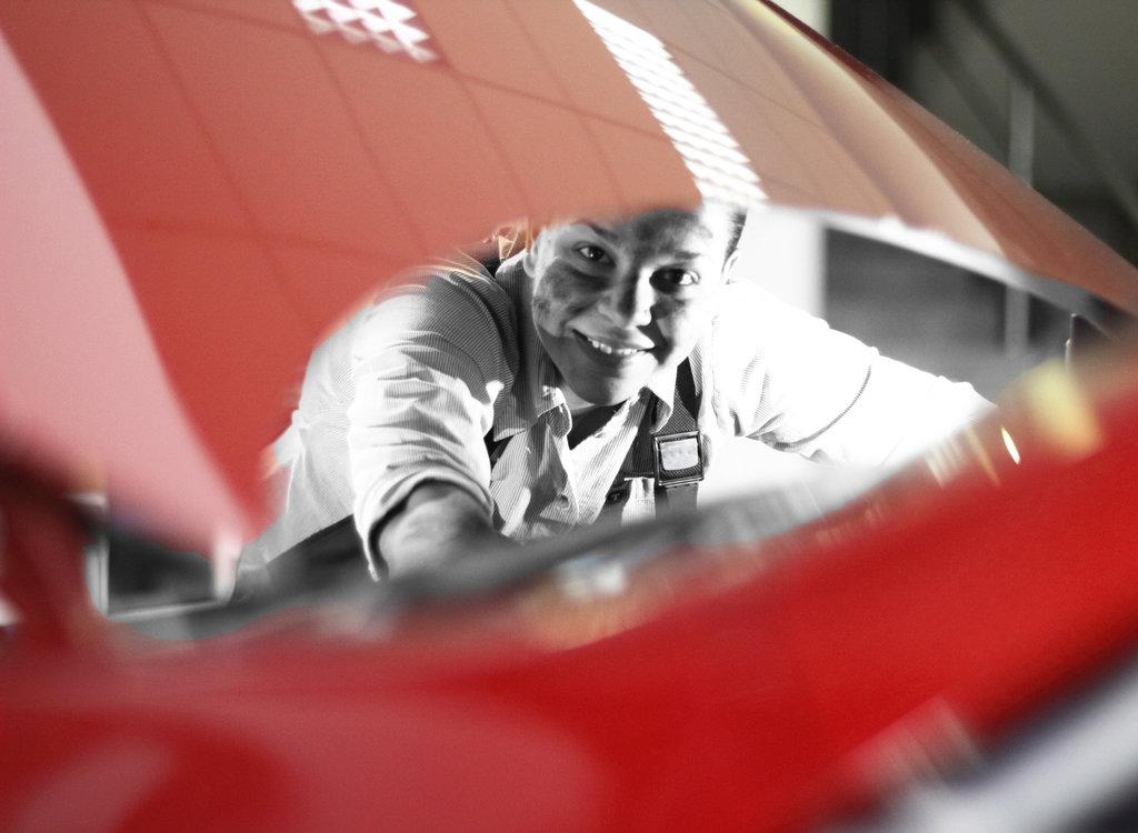 Car mechanic repair an engine